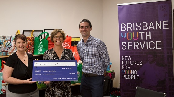 Queensland General Manager Sam Brown presenting MAX Foundation cheque to CEO of Brisbane Youth Service Annemaree Callender with North Brisbane Regional Manager David Avery