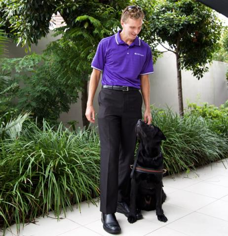 Gerrard Gosens with Guide Dog Boss at MAX Solutions National Support Centre, QLD.